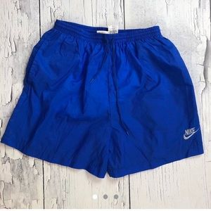 Vintage NIKE shorts Youth L blue silver unisex